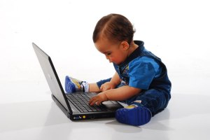 Even this baby knows to email a thank you after an interview.  Via