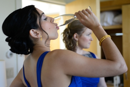 Me as a bridesmaid drinking to my friend's health. [Jennifer May Photography]